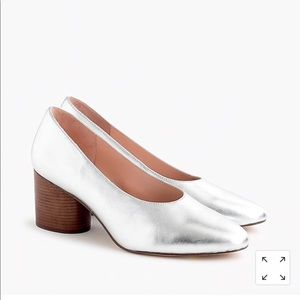 Stacked mid-heel pumps in metallic silver